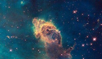 Obraz Jet do mlhoviny Carina. Složený z plynu a prachu.