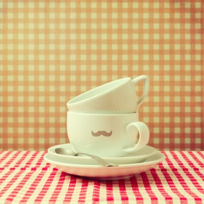 Obraz Kávové šálky s bederní knírem na kontrolovány ubrus