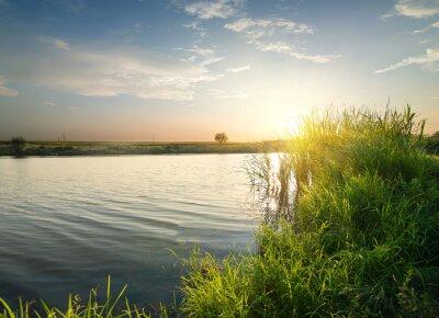 Obraz Klidná řeka při západu slunce