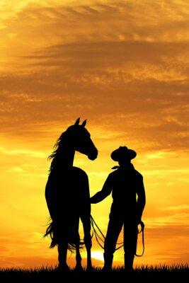 Obraz Kovboj s koněm při západu slunce
