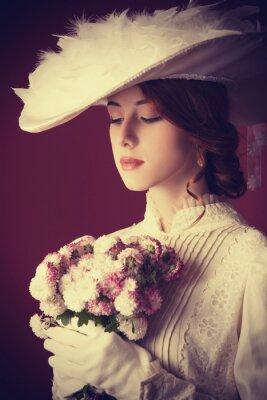 Obraz Krásné zrzka ženy s kyticí
