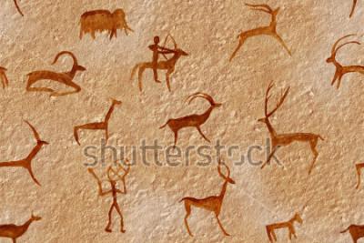 Obraz Kresba bezproblémové v jeskyni namaloval starověký muž na zdi, skály. Barvy červená oranžová okr. Lov zvířete. Šaman, domorodý, neandertálský, jikry, beran, loď, mamut, jelen. Doba kamenná.