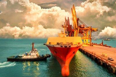 Obraz Logistika a přeprava mezinárodního kontejneru Cargo loď s porty jeřábový most v přístavu a večerní obloha pro logistické dovozní exportní pozadí a dopravní průmysl.