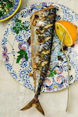 Obraz mackerel - a grill with a lemon and sauce