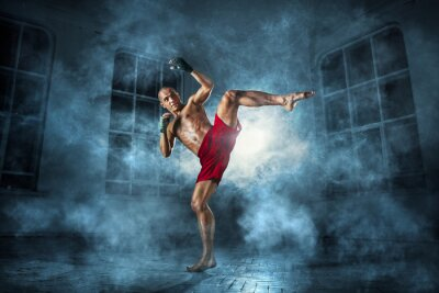 Obraz Mladý muž kickboxing