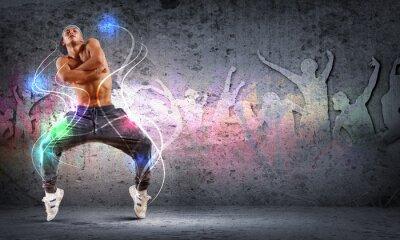 Obraz Mladý muž tančí hip-hop s barevnými linkami