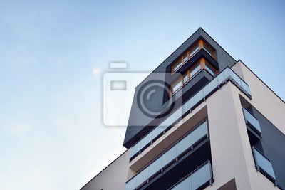 Obraz Modern apartment buildings on a sunny day with a blue sky. Facade of a modern apartment building