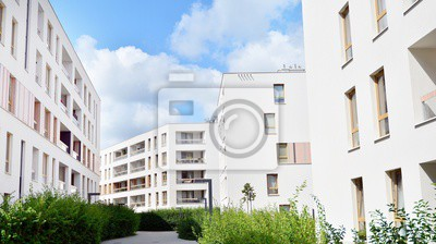 Obraz Modern multi-storey luxury housing concept. Modern apartment building with blue sky and clouds.