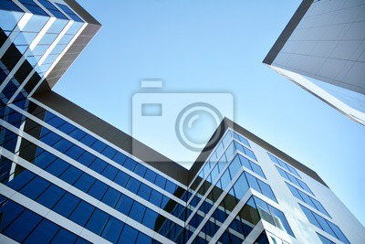 Obraz modern office building with blue sky and clouds