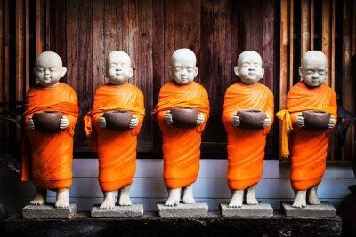 Obraz Monk socha drží misku