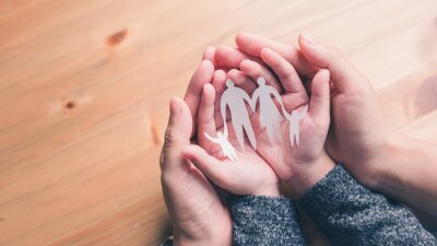 Obraz mother and baby hands holding paper family cutout, Happy family mother, father, children son and daughter.