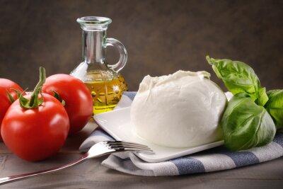 Obraz Mozzarella di bufala con pomodori, basilico e olio extravergine