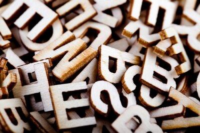 Obraz Neuspořádané dřevěné dopisy zblízka