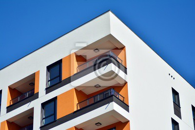 Obraz New-build residential building on a sunny summer day