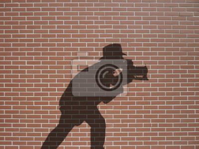 ombre de Fotograf sur briques rtěnky