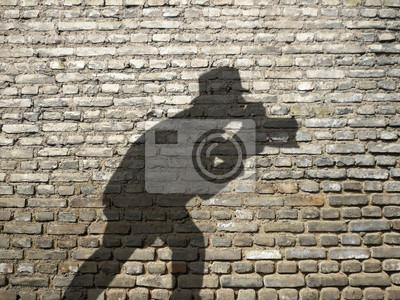 Ombre de Fotograf sur mur de briques