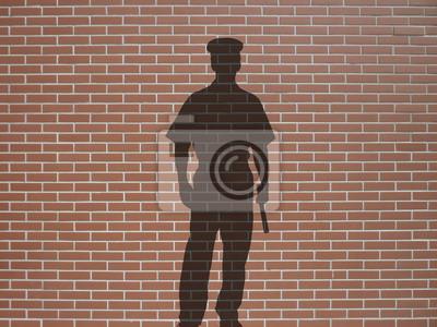 ombre de policier sur briques rtěnky