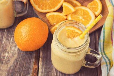 Obraz Oranžové plody smoothie ve skleněné nádobě