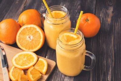 Obraz Oranžové plody smoothie ve sklenicích