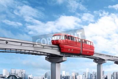 Obraz Red jednokolejné vlak proti modré obloze a moderní město v pozadí