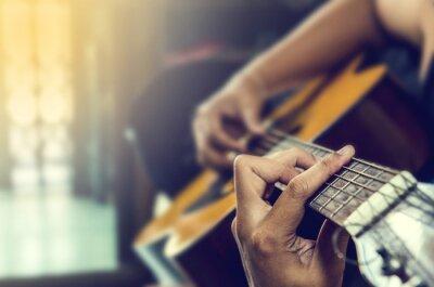 Obraz ruka muže v klasickou kytaru