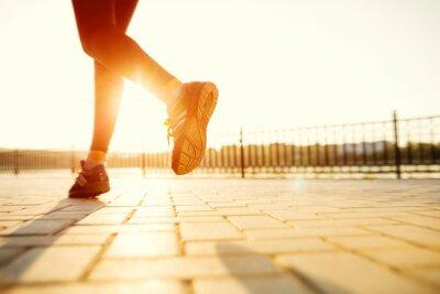 Obraz Runner feet running on road closeup on shoe. woman fitness sunri