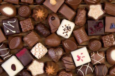 Obraz Různé čokolády na dřevěné pozadí