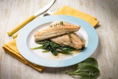 Obraz rybí filé s čerstvým špenátem