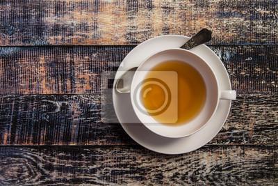 Obraz Šálek čaje na dřevěném pozadí
