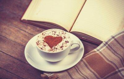 Obraz Šálek kávy a knihy s šátkem