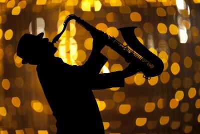 Obraz Saxofonista. Muž hrající na saxofon