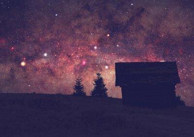 Obraz Siluety krajiny s Mléčné dráhy. Dlouhé foto expozice převzat z tmavého vrcholu hory.