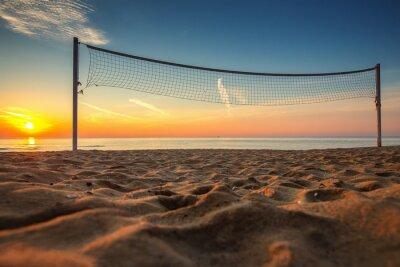 Obraz Síť na volejbal a východ slunce na pláži