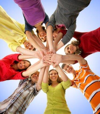 Obraz Skupina happy teenageři drží ruce