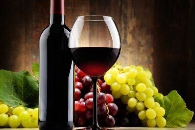 Obraz Složení se sklem, láhev červeného vína a čerstvých hroznů