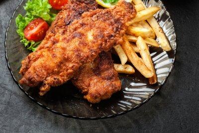 Obraz Smažené ryby v křupavém těstíčku s čipy