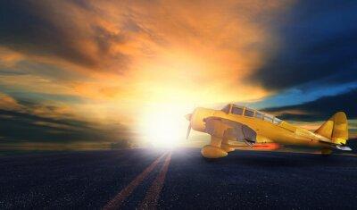 Obraz staré žluté vrtule letadlo na letištní ranvej s Západ slunce bac