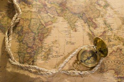 Obraz Starý kompas a lano na vintage mapě