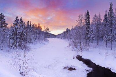 Obraz Sunrise over a river in winter near Levi, Finnish Lapland