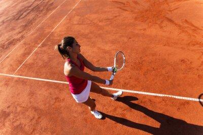 Obraz Tenistka sloužící tenisový míček