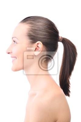 usměvavé krásná mladá žena hledá bokem izolované