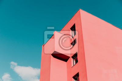 Obraz View from below on a pink modern house and sky. Vintage pastel colors, minimalist concept.