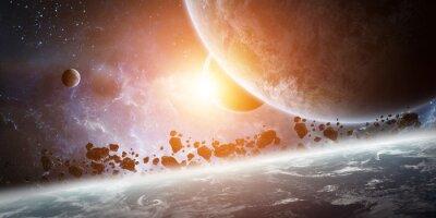 Obraz Východ slunce nad Zemi ve vesmíru