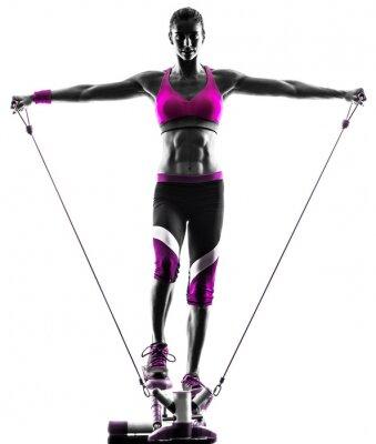 Obraz woman fitness stepper resistance bands exercises