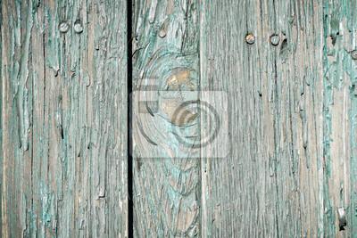 Zblízka staré zvětralé prkna s oprýskaných nátěrů