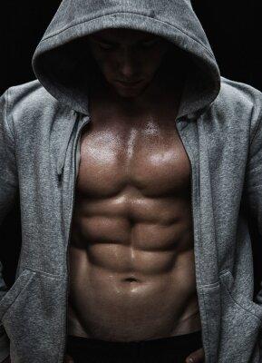 Obraz Zblízka svalové sportovní člověka po závaží školení