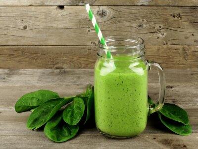 Obraz Zdravé zelené smoothie se špenátem ve sklenici hrnek na dřevo
