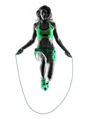 Obraz žena fitness cvičení skákání přes švihadlo Silhouette