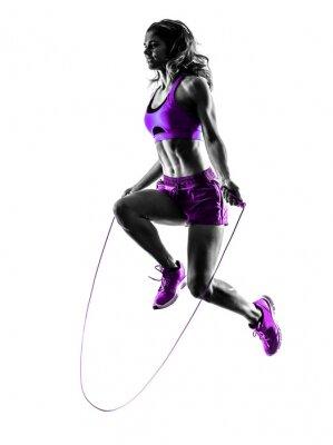 Obraz žena fitness skákání přes švihadlo cvičení silueta