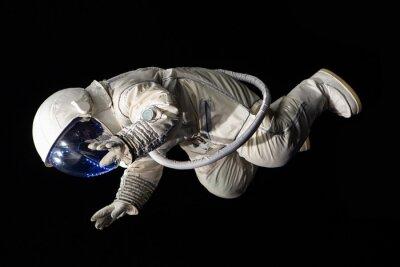 Plakát astronaut na černém pozadí